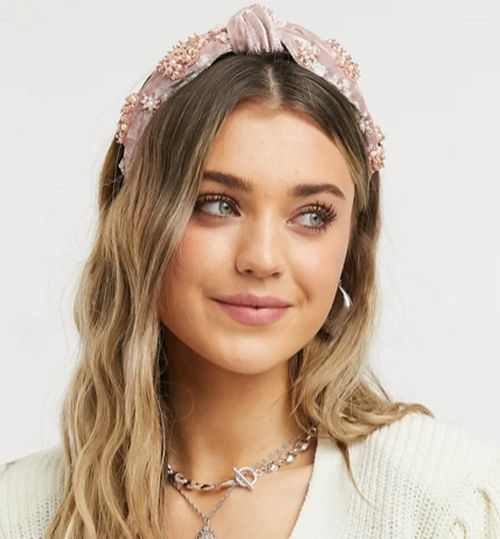 ASOS DESIGN knot headband with pearl flower embellishment in blush pink