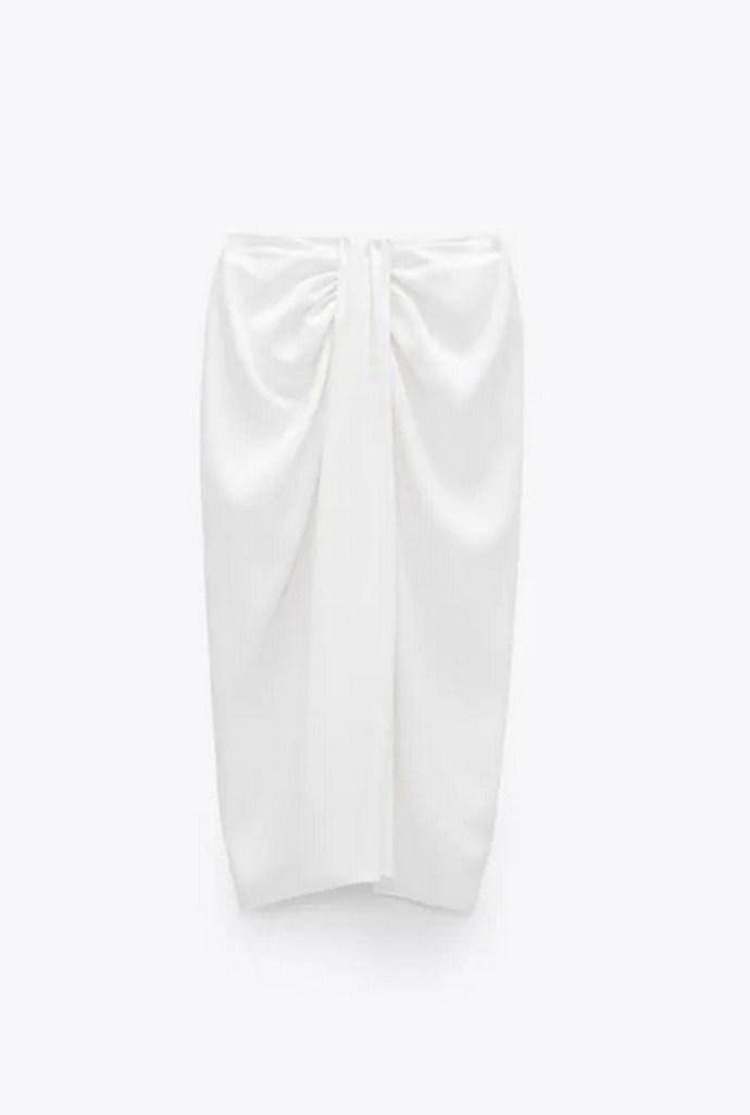 Ψηλόμεση φούστα με λεπτομέρεια με κόμπο και πιέτες μπροστά